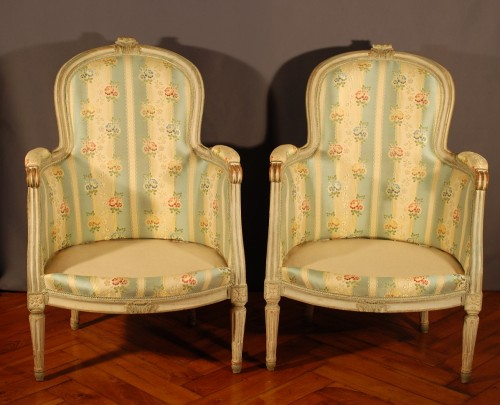 A french Louis XVI pair of wing chairs -
