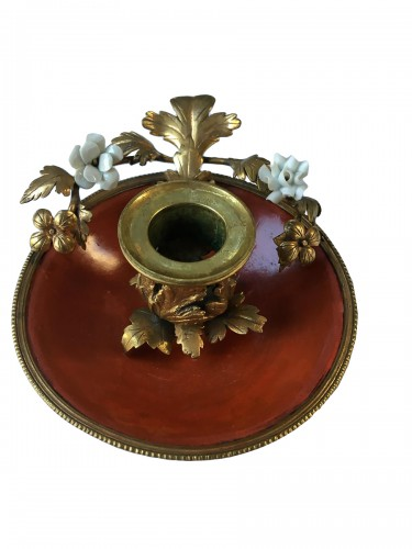 A Louis XV lacquered candlestick