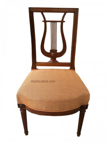 Suite of 12 chairs with lyre back