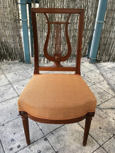 Suite of 12 chairs with lyre back -