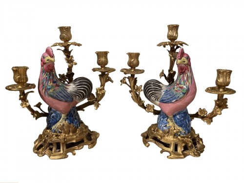 Pair of roosters mounted in candelabra