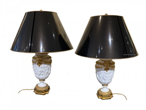 Pair of late 19th century biscuit vases mounted as lamp