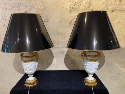 Pair of late 19th century biscuit vases mounted as lamp -