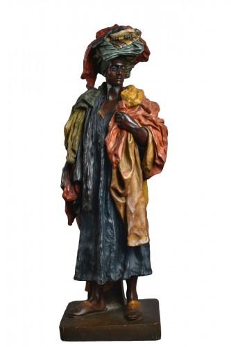 Friedrich Goldscheider (1845 – 1897) - The Fabric Seller in terracotta