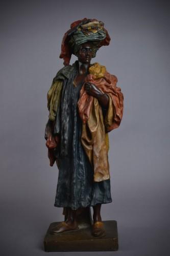 Sculpture  - Goldscheider - The Fabric Seller in terracotta