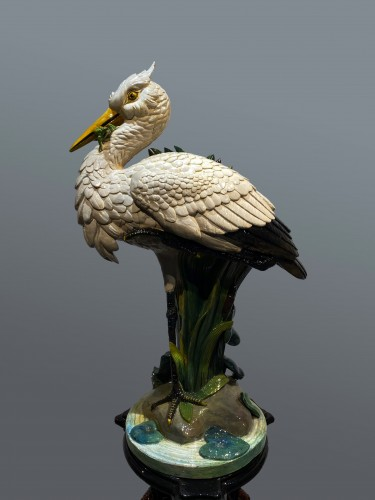 Ceramic slip - Heron with the frog on its column -