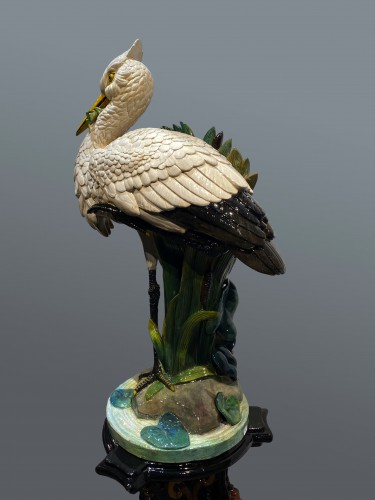 20th century - Ceramic slip - Heron with the frog on its column