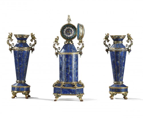 A austrian silver-gilt enamel and lapis clock garniture. Herman Boehm.