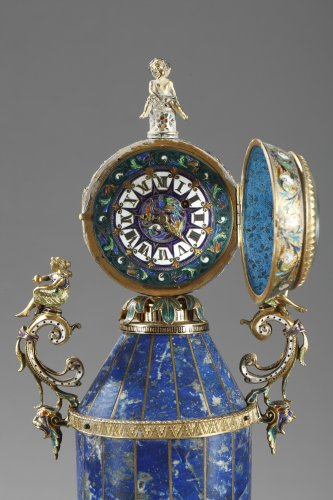 A austrian silver-gilt enamel and lapis clock garniture. Herman Boehm.  -