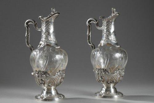 Pair of cut-crystal ewers set in silver. 19th century