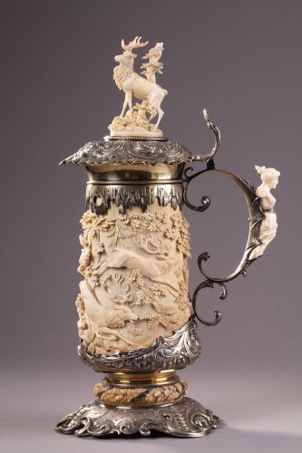A Silver mounted relief carved ivory tankard