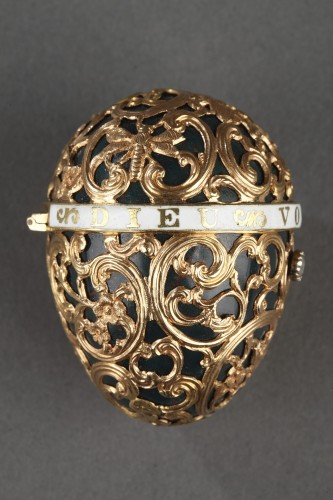 A 18th century gold cage work mounted bloodstone egg .  - Transition