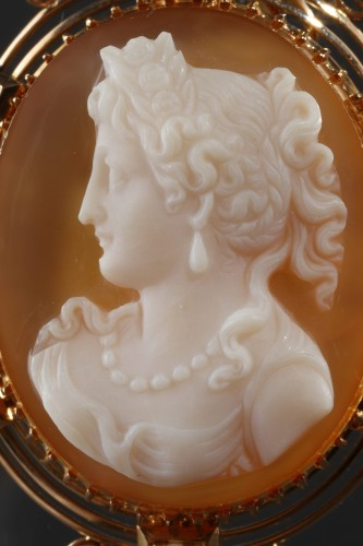 19th century - Cameo on orange-pinkagate featuring a young woman looking toward the left.