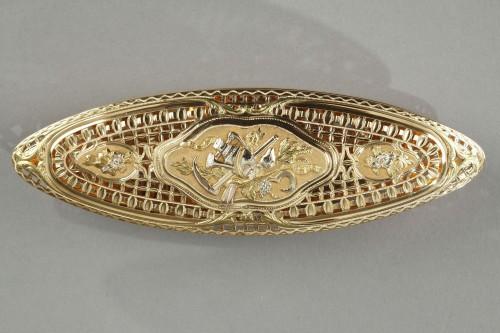 A Louis XV gold knotting shuttle -
