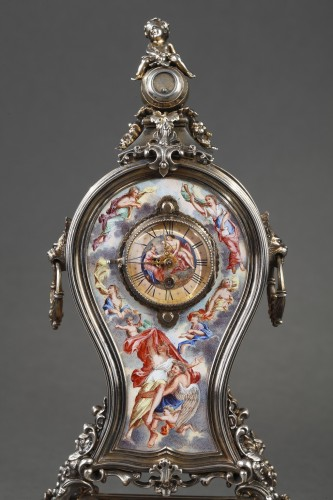 Horology  - A 19th century VIENNESE SILVER AND ENAMEL TABLE CLOCK.