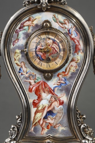 Antiquités - A 19th century VIENNESE SILVER AND ENAMEL TABLE CLOCK.