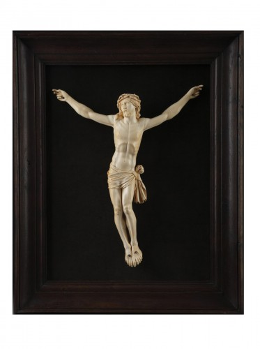A 18th century carved ivory figure of the crucified christ