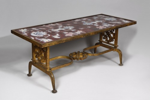 20th century - Cast iron and ceramic coffee table, Gilbert Poillerat (1902 - 1988)