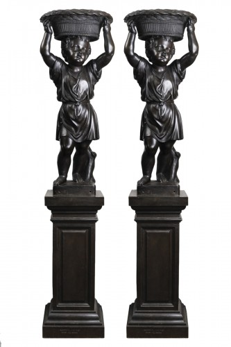 Pair of bronze cherubs forming a flowerpot