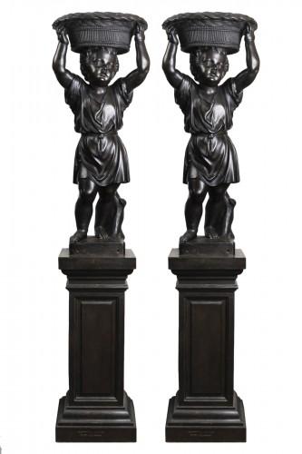 Pair of bronze cherubs forming a flowerpot