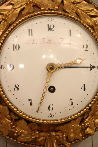 Bull's eye decorated with gilded bronzes from the Louis XVI period - Horology Style Louis XVI