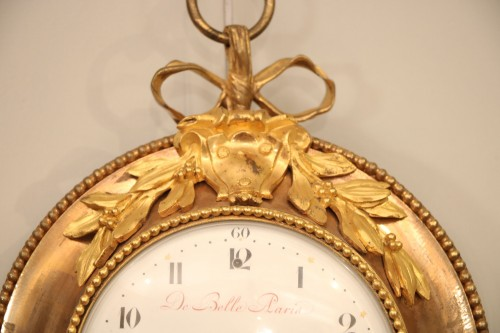 Horology  - Bull's eye decorated with gilded bronzes from the Louis XVI period