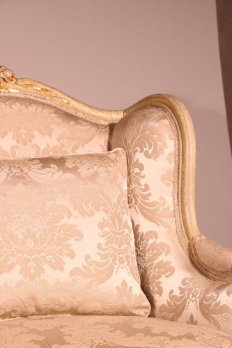 "A french Louis XV Lacquered and gilded ""Canapé à oreille"" -"