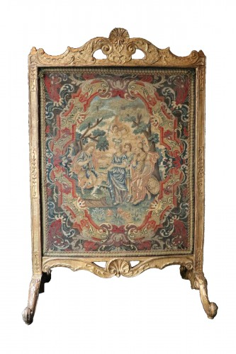 Large fire screen in gilt wood