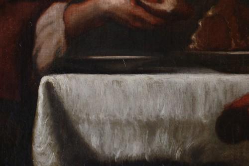 17th century Caravaggio School: Jesus shares bread with the Pilgrims of Em -