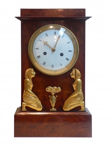 An Empire Egyptian revival ormolu mounted clock, circa 1805