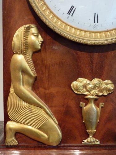 Clocks  - An Empire Egyptian revival ormolu mounted clock, circa 1805
