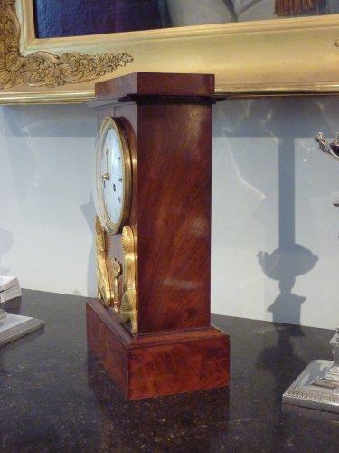 An Empire Egyptian revival ormolu mounted clock, circa 1805 -