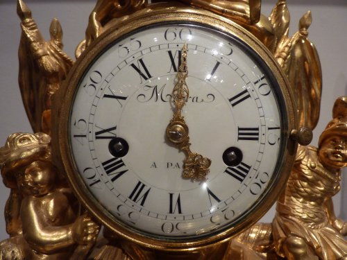 Clocks  - A Louis XVI gilded bronze mantel clock by Pierre Martin Merra