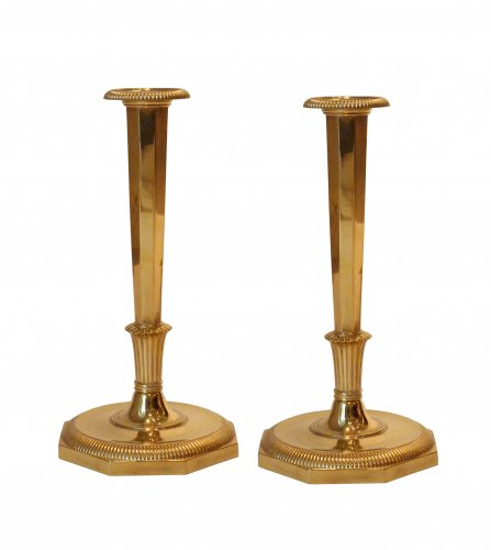 A pair of Empire ormolu clandlesticks attributed to Claude Galle