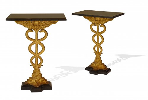 A pair of black marble and gilt cast iron side tables