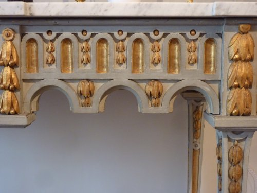 An important gilded and grey painted Louis XVI period console table -