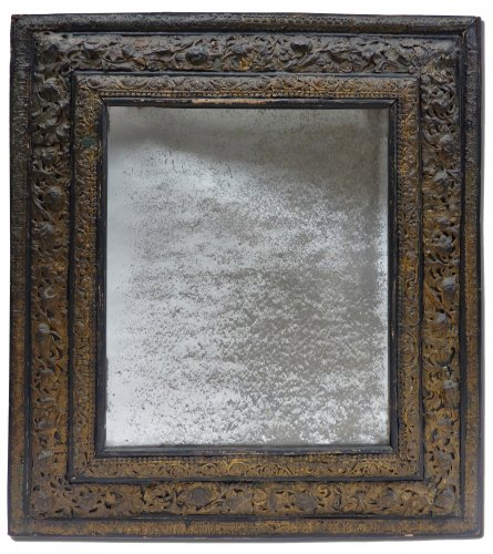 A Louis XIV mercury mirror decorated with embossed brass plates