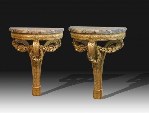 A pair of giltwood console tables after the design of Richard de Lalonde