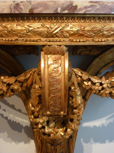 A pair of giltwood console tables after the design of Richard de Lalonde -