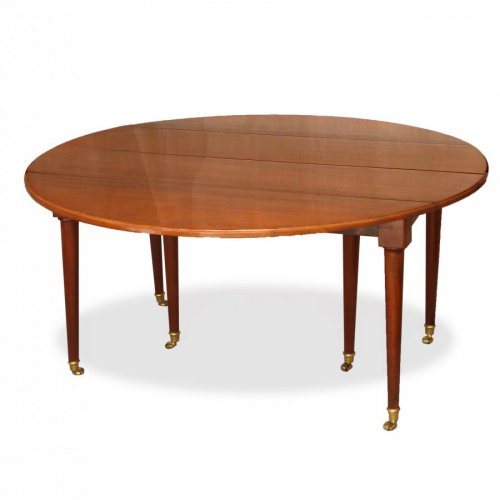 A Louis XVI solid mahogany extending dining table