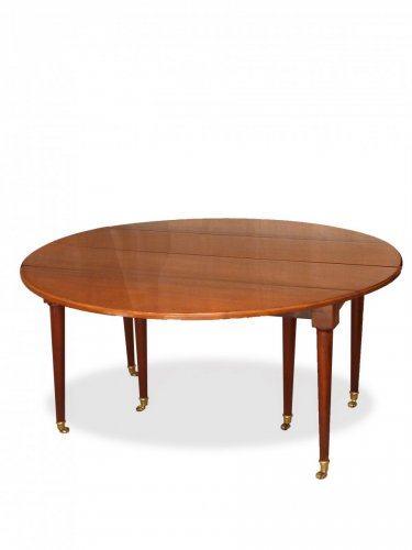 Furniture  - A Louis XVI solid mahogany extending dining table