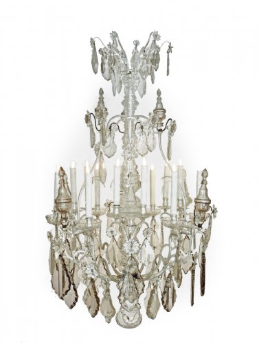 A large silvered bronze and crystal twelve-light chandelier