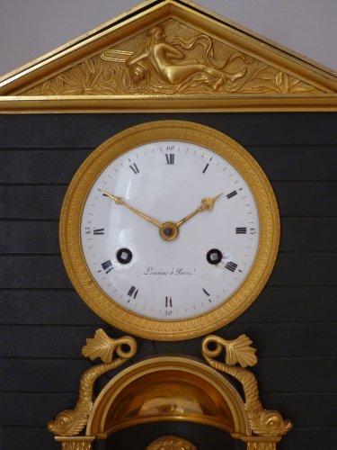 "Clocks  - An Empire ormolu and patinated bronze clock ""pendule à la fontaine"""