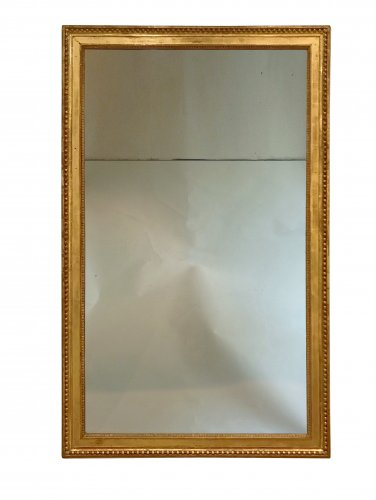 A large Louis XVI giltwood wall mirror