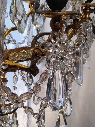 Lighting  - A French gilt bronze and crystal six light chandelier, circa 1850