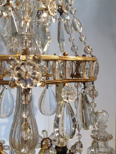 A French gilt bronze and crystal six light chandelier, circa 1850 -