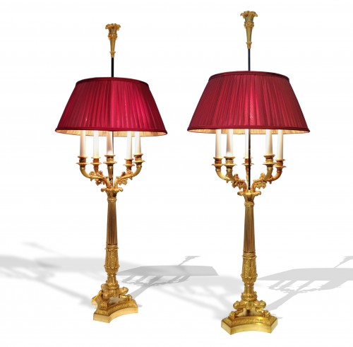 A pair of gilded bronze Restauration bouillotte candélabras