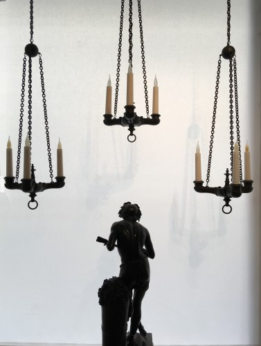 A set of three neo-pompeian patinated bronze chandeliers -