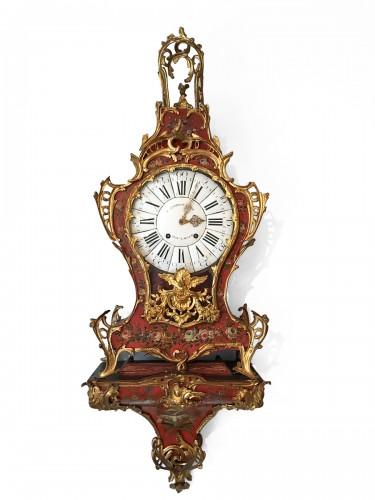 A Louis XV ormolu mounted vernis européen cartel clock