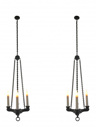 A pair of three-light patinated bronze chandeliers in the antique manner